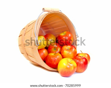 Apples in a wooden farmer's basket, isolated - stock photo