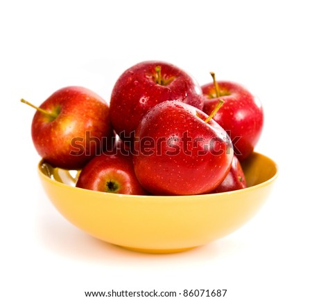 Apples in a yellow bowl on white - stock photo