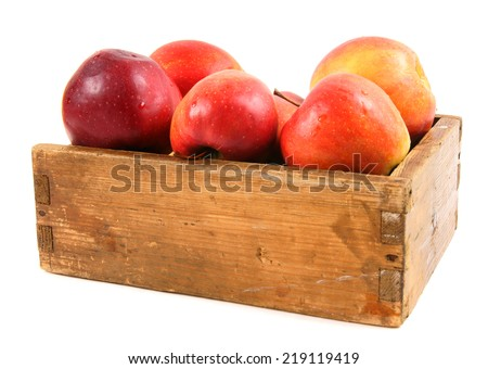 Apples in an old box on a white background. - stock photo