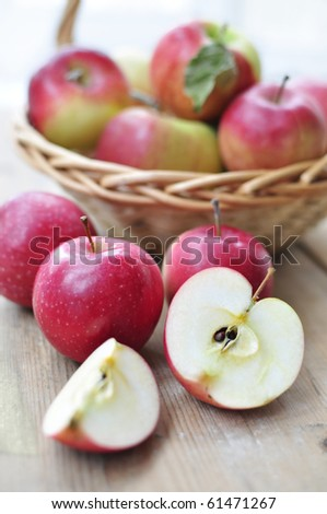 Apples in the basket and on the table - stock photo