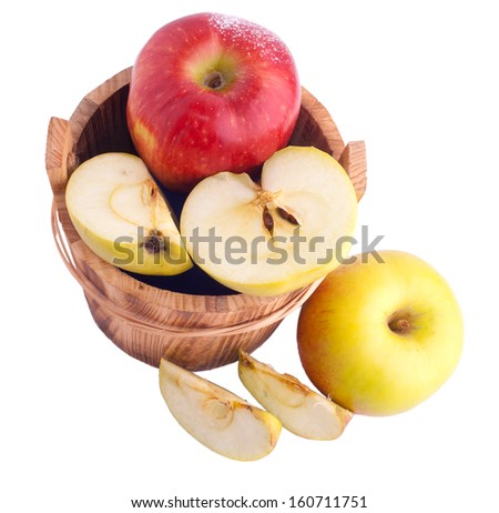 Apples in wooden bucket over white - stock photo