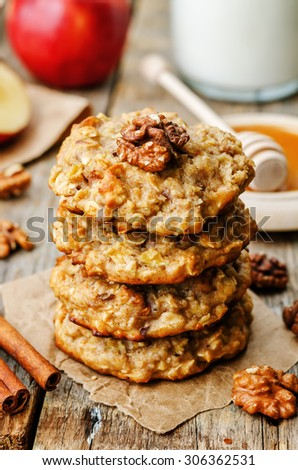 apples oats cinnamon cookies on a dark wood background. the toning. selective focus - stock photo