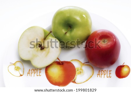 Apples on a plate - stock photo