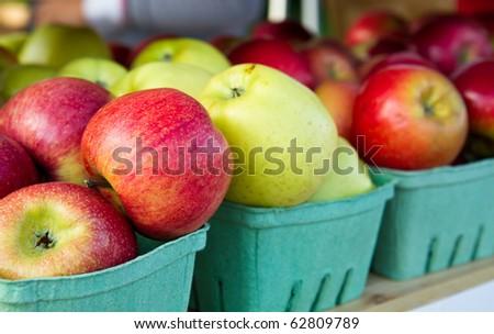 Apples on a shelf at a farmer's market - stock photo