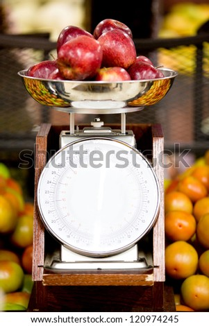 Apples on a weight scale at the supermarket - stock photo