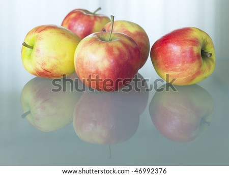 Apples on glass table