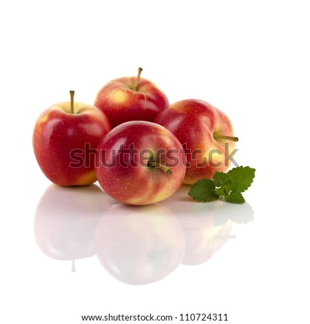 apples on reflective white background