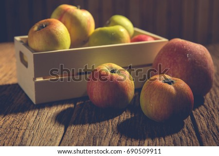 Apples on the plate on a wooden.