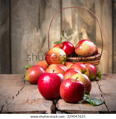 Apples oraganic on wooden background. Nature fruit concept.