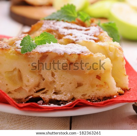Apples pie and mint leaves - stock photo