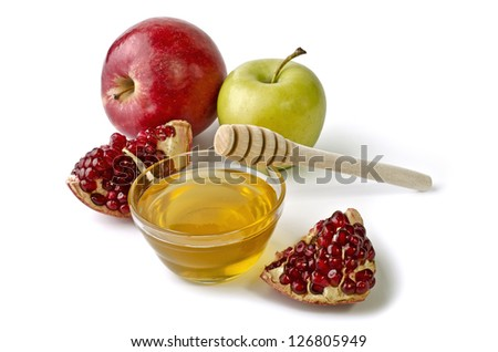 Apples, pomegranate and bowl of honey over white. Illustration of Rosh Hashanah (jewish new year) or Savior of the Apple Feast Day - stock photo