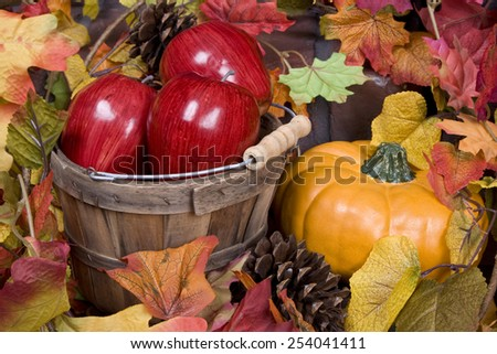 Apples, pumpkins and fall leaves - stock photo