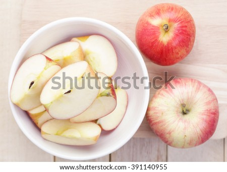Apples sliced on wood table.The concept of food to lose weight. - stock photo
