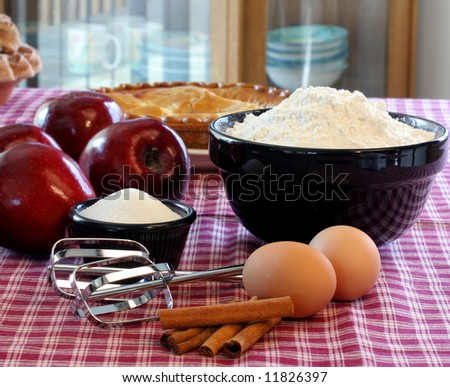 Apples with ingredients to prepare apple pie. - stock photo