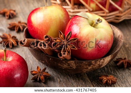 Apples with spices: cinnamon, star anise on a wooden background - stock photo