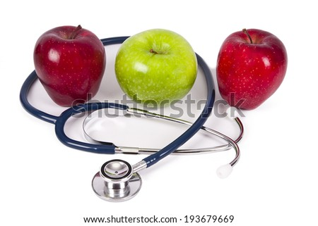 apples with stethoscope concept of healthy diet - stock photo