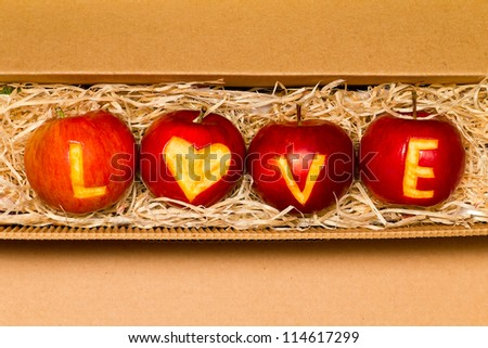 Apples with word love - stock photo