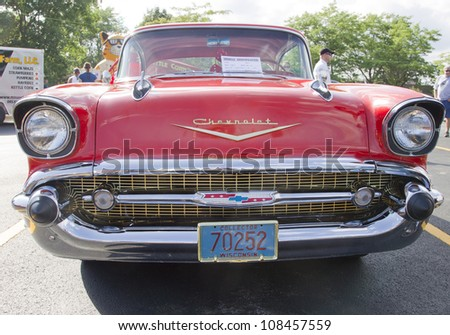 APPLETON, WI - JULY 21: Front view of a Red 1957 Chevy Chevrolet Bel Air Two Door at the 18th Annual WVBO Classic Car Show at Fox Valley Technical College on July 21, 2012 in Appleton, Wisconsin. - stock photo