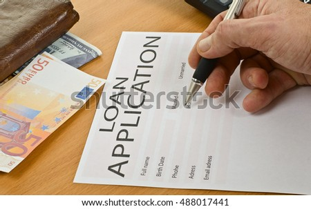 application form for car loan,  pen, calculator, money,  wallet