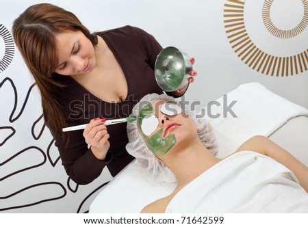 Application seaweed mask - stock photo