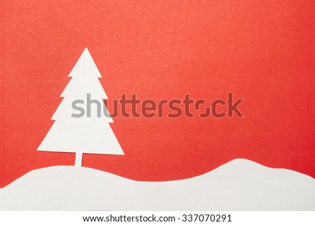 Applique with a New Year tree, cutted out of paper. - stock photo