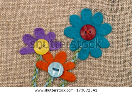 Appliqued with flowers made ??of felt with the buttons. Card for Women's Day. - stock photo