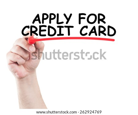 Apply for credit card concept made on transparent wipe board with a hand holding a marker - stock photo
