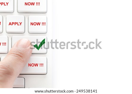apply job concept : human finger pressing on white keyboard isolated on white background - stock photo