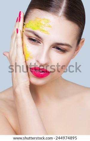 Applying face scrub - stock photo