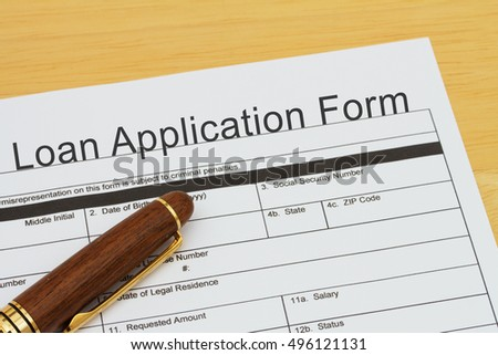 Applying for a Loan, Loan application form with a pen on a desk