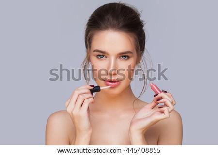 applying lip-gloss - stock photo