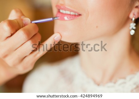 applying make up to brides lips
