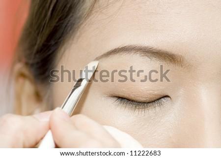 applying makeup - stock photo