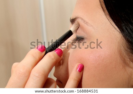 Applying makeup - stock photo