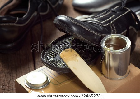 applying rubber adhesive to the shoe, shoe repair - stock photo