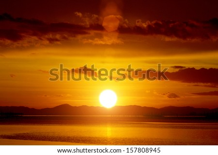 Appreciated the sunset on the lake, southern Thailand. - stock photo