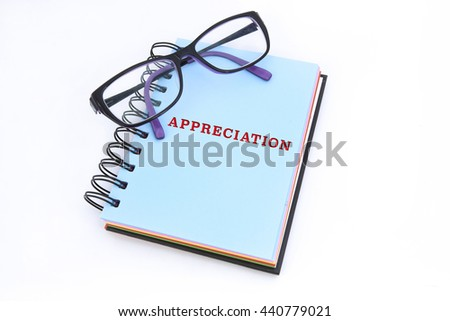APPRECIATION word in blue notepad - stock photo