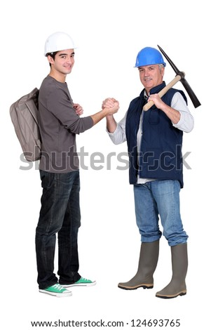 apprentice and senior bricklayer isolated on white - stock photo