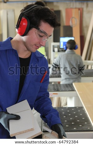 Apprentice carpenter - stock photo
