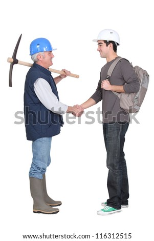 Apprentice shaking hands - stock photo