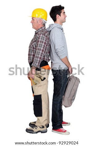 Apprentice stood with master - stock photo