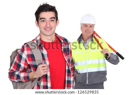 Apprentice stood with mentor - stock photo