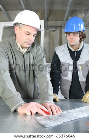 Apprenticeship with a zinc worker - stock photo