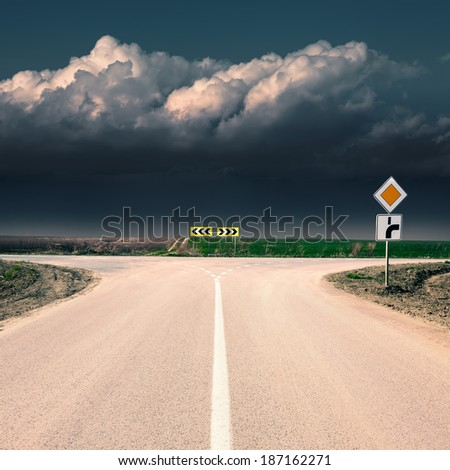 Approach an intersection against the upcoming storm - stock photo