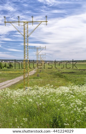 Approach Lighting System by Airport in Umea, Sweden - stock photo