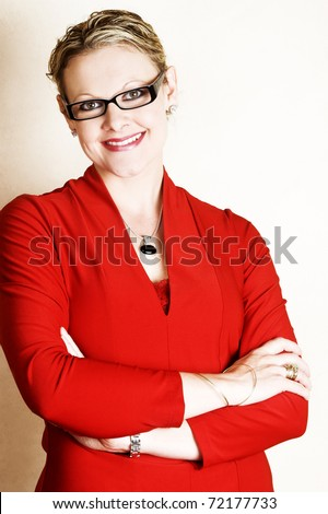 Approachable business woman in a red suit - stock photo
