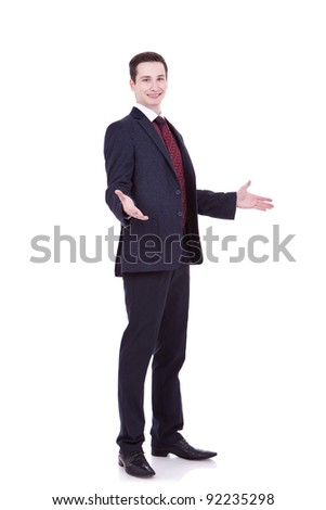 Approachable young business man with open arms isolated - stock photo