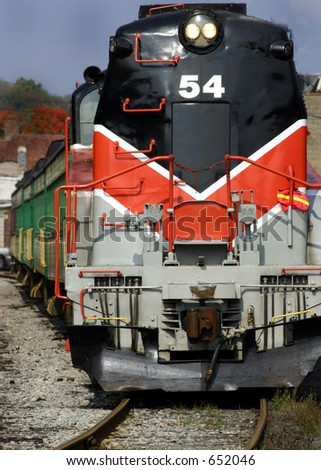 Approaching bright colored Train, diesel engine on the tracks