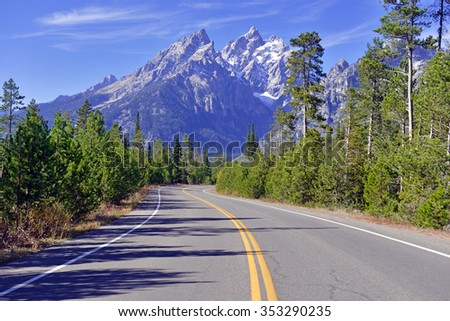 Approaching Grand Teton and the Teton Range, Grand Teton National Park, Wyoming, USA - stock photo