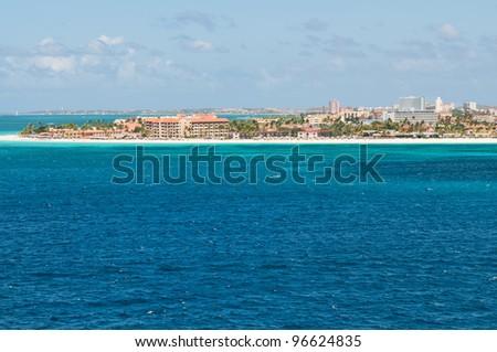 Approaching Oranjestad, Aruba, Netherlands Antilles by sea - stock photo